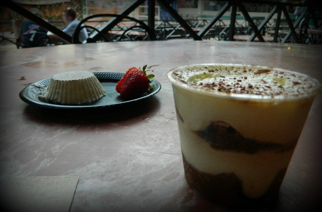 Italy: (L) Panna Cotta - Vanilla cream pudding served with strawberries - (R) Tiramisu - Italian parfait with sweetened mascarpone cheese layered with espresso soaked lady fingers.
