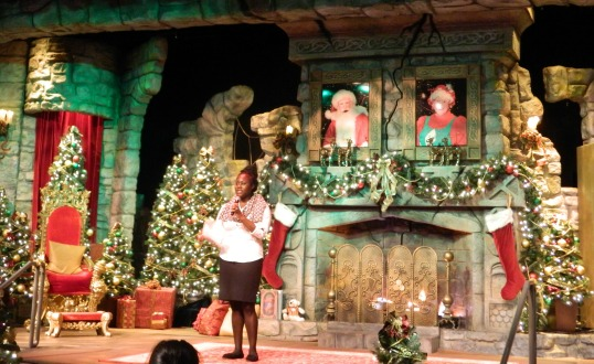 Koy Grant, from the park's Communications Department, welcomes everybody to Santa's Fireside Feast.