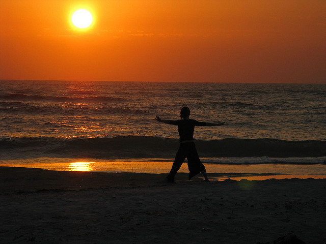 Beach yoga by sunset. Photo: Flickr/Andrew Kalat/Creative Commons license