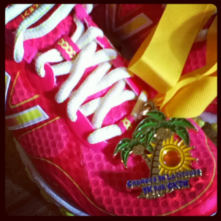 My bright pink shoes and my first ever 5K medal. It's Buffett-themed and benefits Give Kids the World. My worlds have collided in a good way.
