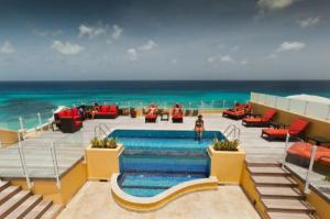 Rooftop pool at the Ocean Two Resort & Residence, Barbados. Photo: PRNewsFoto/Regatta Travel Solutions